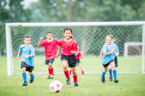 chasing the ball - soccer league stock pictures, royalty-free photos & images