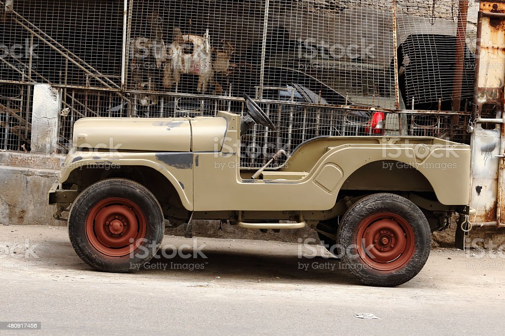 chasis of a jeep being modified  and painted stock photo