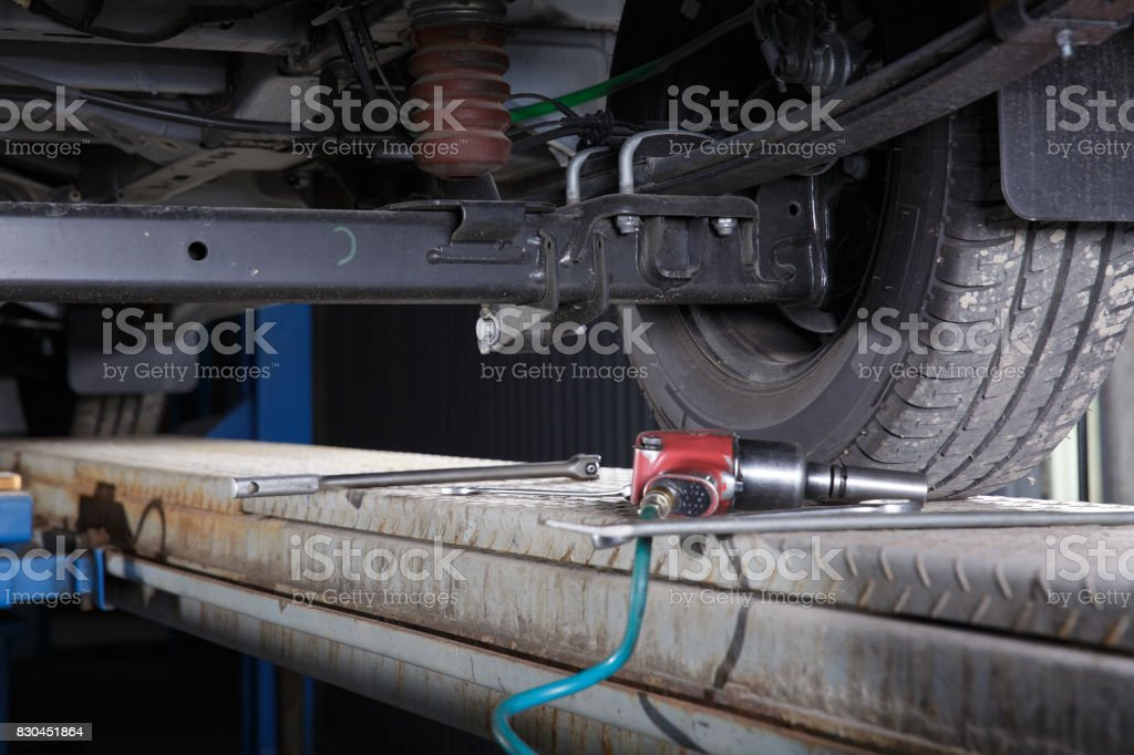 chassis of a car on the lift stock photo