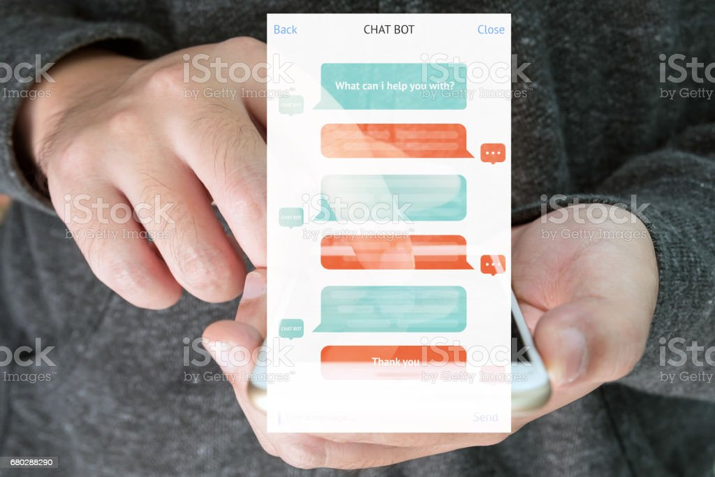 Chat bot and future marketing concept , automatic chatbot message screen with hand holding mobile phone background stock photo