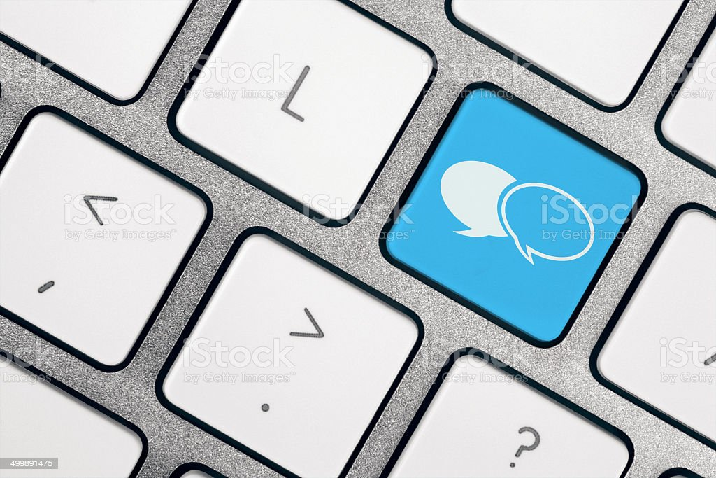 Chat icon on blue button on computer keyboard. Stock image of symbol...
