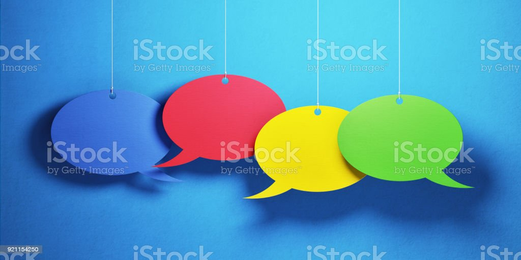 Colorful chat bubbles over blue background. Panoramic composition...