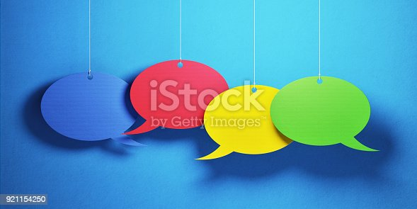 istock Chat Concept - Colorful Chat Bubbles Over Blue Background 921154250