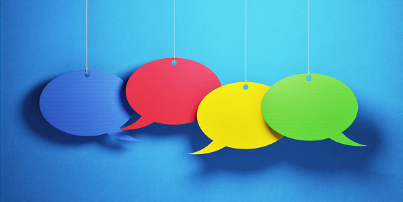 921154250 istock photo Chat Concept - Colorful Chat Bubbles Over Blue Background 921154250