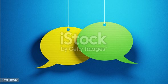 istock Chat Concept - Colorful Chat Bubbles Over Blue Background 923013548