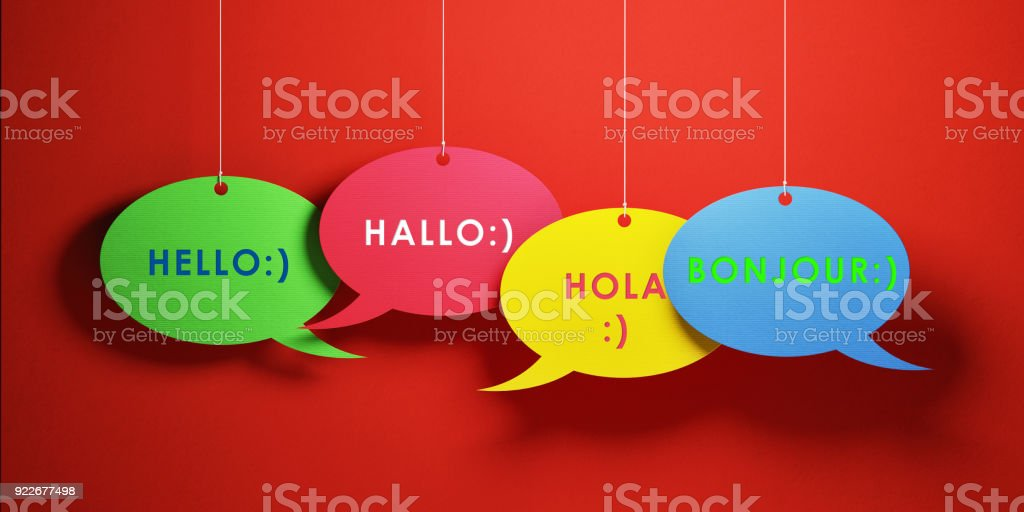 Colorful chat bubbles with greetings in different languages over red...