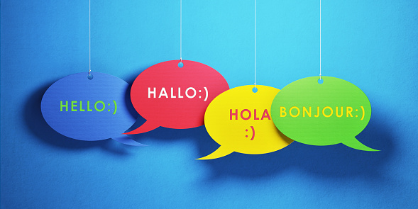 921154250 istock photo Chat Concept - Colorful Chat Bubbles With Greetings In Different Languages Over Blue Background 922678000