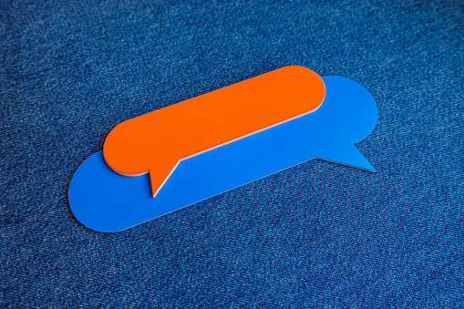 921154250 istock photo Chat Concept - Orange and Blue Chat Bubbles Over Blue Background. 1209692405