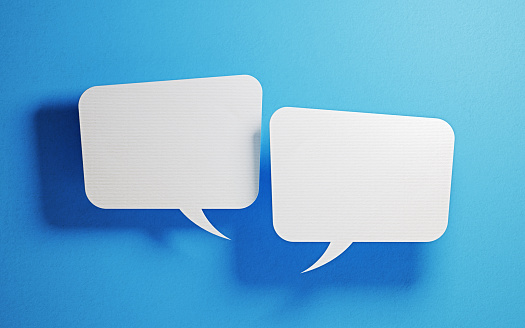 921154250 istock photo Chat Concept - White Chat Bubbles Over Blue Background 919987540