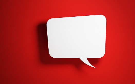 921154250 istock photo Chat Concept - White Square Shaped Chat Bubble Over Red Background 921145672