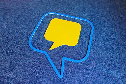 921154250 istock photo Chat Concept - Yellow and Blue Chat Bubbles Over Blue Background. 1209695593