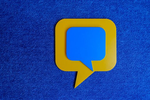 921154250 istock photo Chat Concept - Yellow and Blue Chat Bubbles Over Blue Background. 1210019026