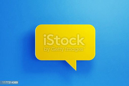 istock Chat Concept - Yellow Chat Bubble on Blue Background 1177314069