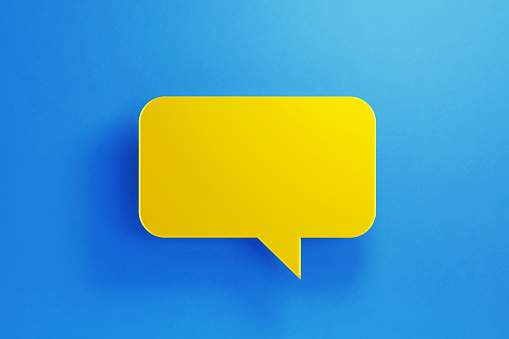 921154250 istock photo Chat Concept - Yellow Chat Bubble on Blue Background 1177314069