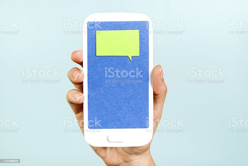 Chat message on phone concept on blue background stock photo