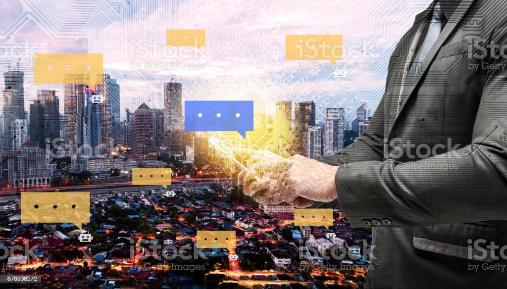 Chatbot and internet of things concept. Double exposure of Electric circuit graphic , technology chat bot dialog.Business man suit hand using smart phone with city background. – Foto