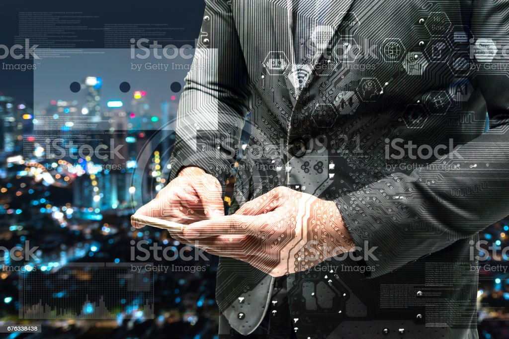 Chatbot and internet of things concept. Double exposure of Electric circuit graphic , technology chat bot icons.Business man suit hand using smart phone with blur bokeh city background. – Foto