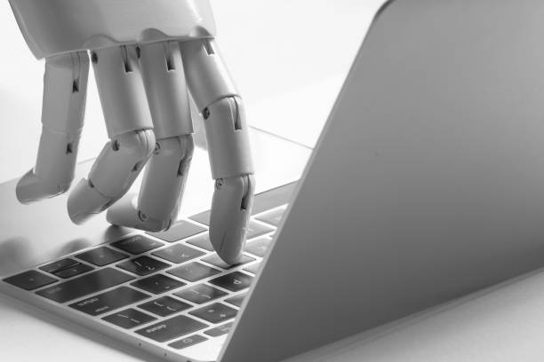 Chatbot , artificial intelligence , robo advisor , robotic concept. Robot finger point to laptop button. stock photo