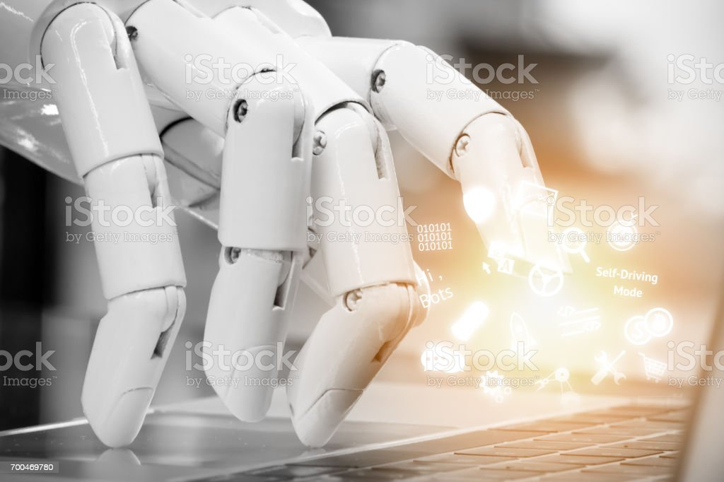 Chatbot , artificial intelligence , robo advisor , robotic concept. Robot finger point to laptop button and infographic icons with flare light effect. stock photo
