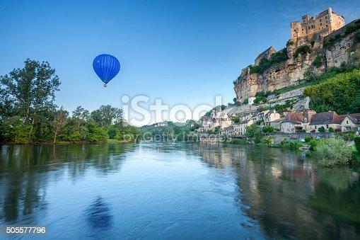 istock Chateau Beynac and a hot air balloon 505577796