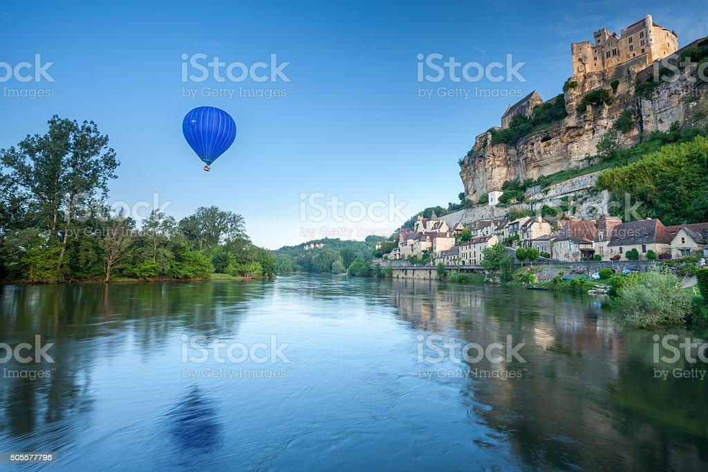 Chateau Beynac and a hot air balloon stock photo