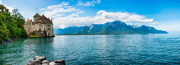 chateau de chillon on the shore of lake geneva,switzerland - lake geneva stock photos and pictures