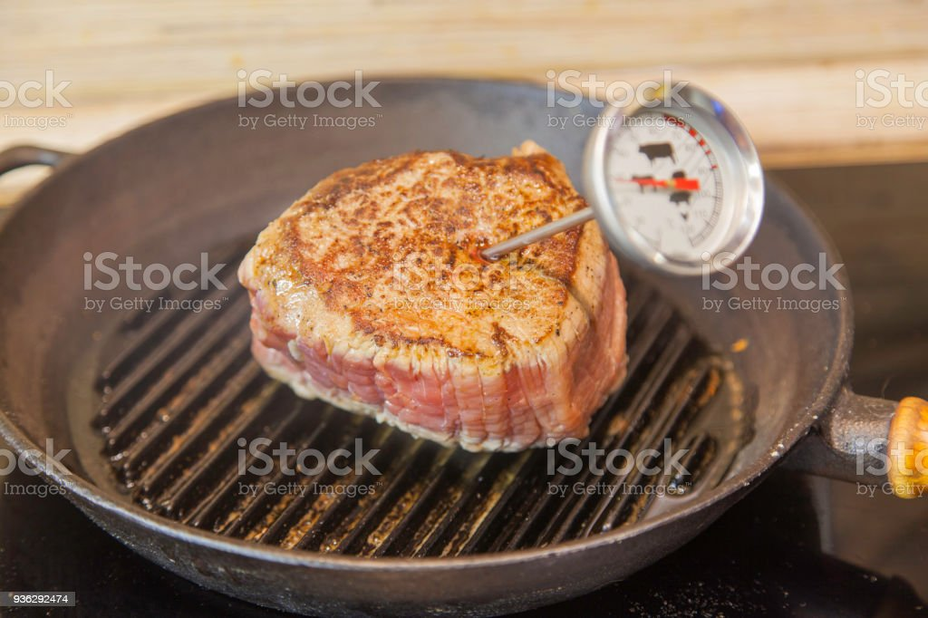 Chateaubriand steak grilling stock photo