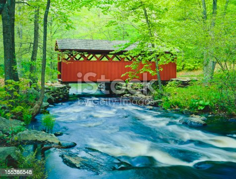 Chatfield Hollow covered bridge crosses a fast flowing stream in Chatfield Hollow State Park