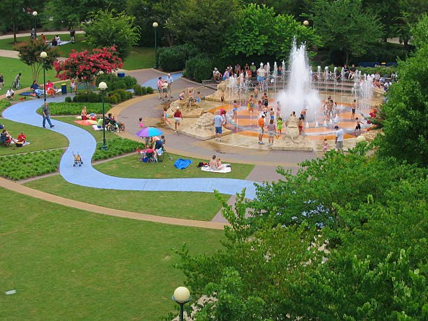 Chattanooga Family Fun Aerial view of green public park in Chattanooga, Tennessee with children playing in fountain chattanooga stock pictures, royalty-free photos & images