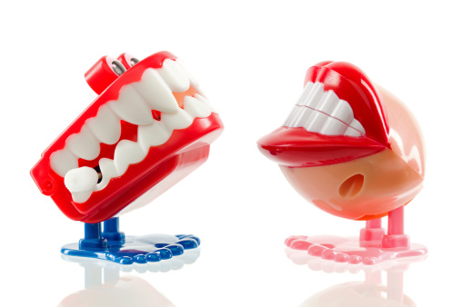 Vintage chattering teeth toy, isolated on white.