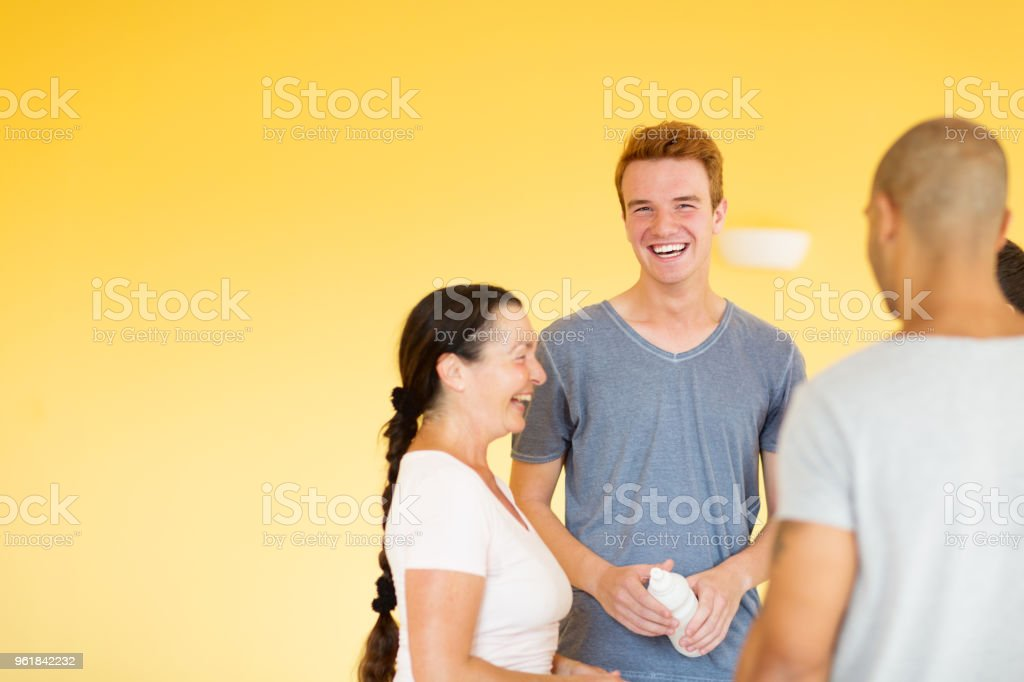 chatting and laughing, wellbeing after exercising stock photo
