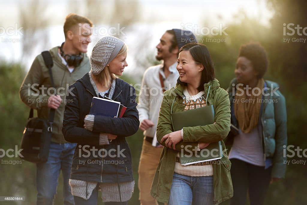 Chatting on the way to class royalty-free stock photo