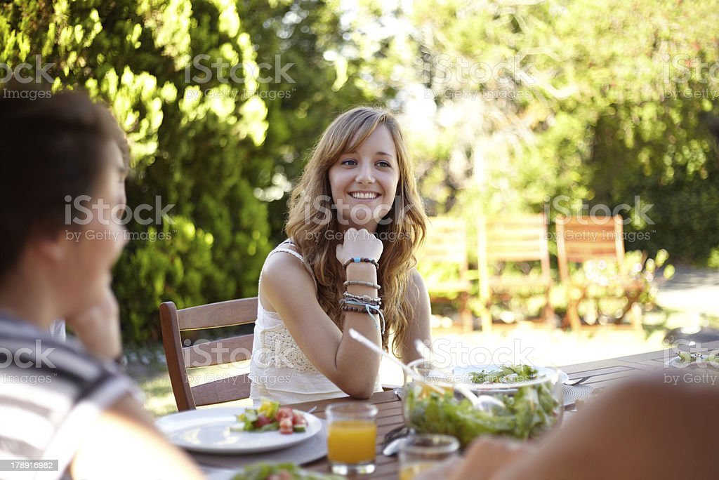 Chatting over a healthy meal royalty-free stock photo