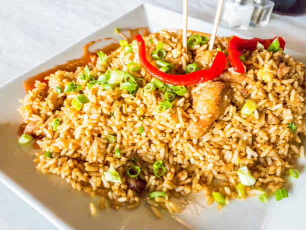 Arroz Chaufa Arroz Chaufa authentic and traditional Peruvian Chinese dish called *chifa*. arroz stock pictures, royalty-free photos & images