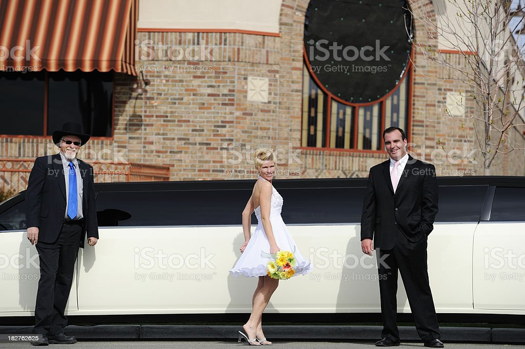 Chauffer With Limousine And Happy Newlyweds royalty-free stock photo