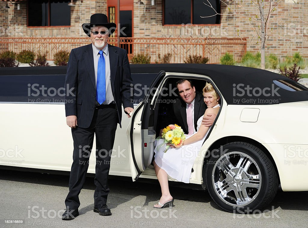 Chauffer With Limousine And Newlyweds royalty-free stock photo
