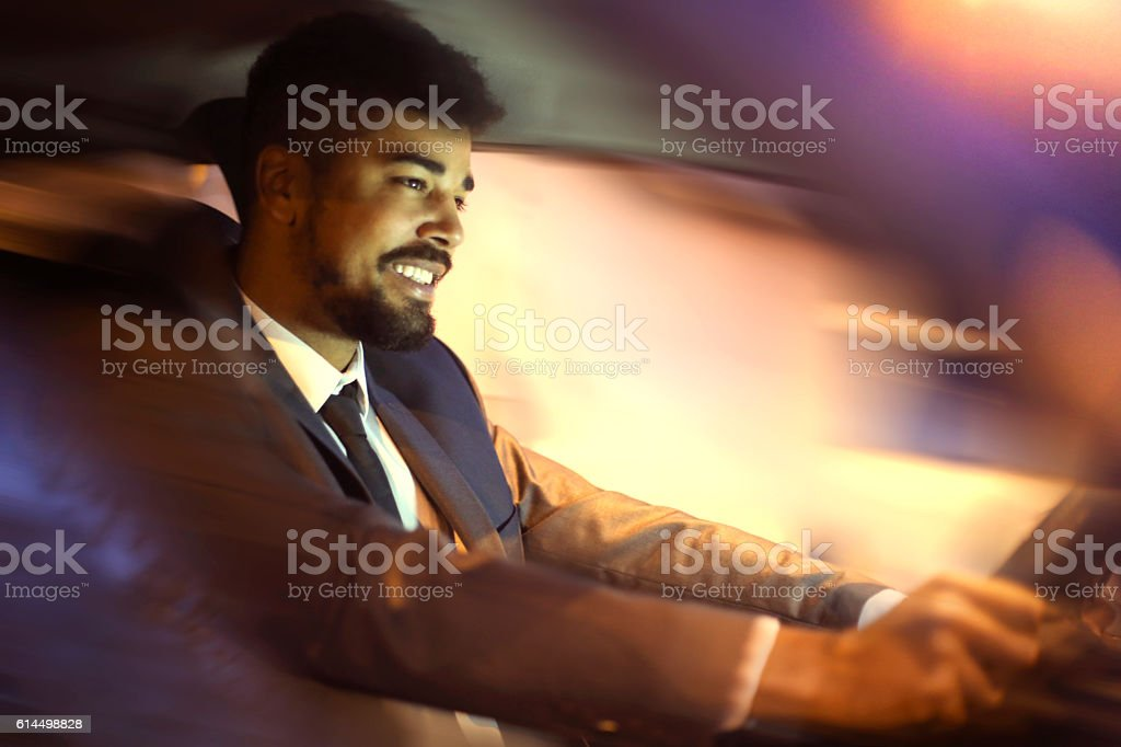 Chauffeur driving car stock photo