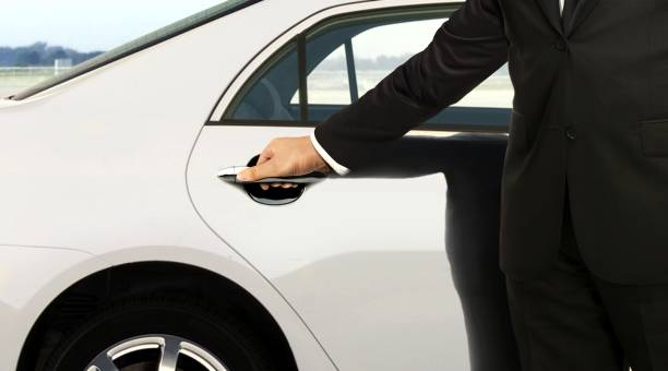 chauffeur hand opening car door - limousine service stock photos and pictures