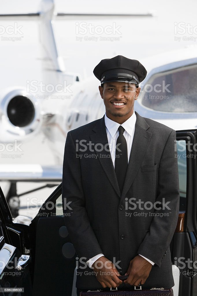 chauffeur in front of airplane stock photo