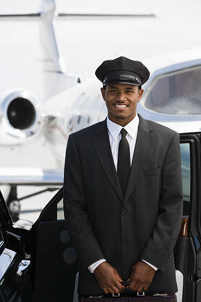 chauffeur in front of airplane - limousine service stock photos and pictures