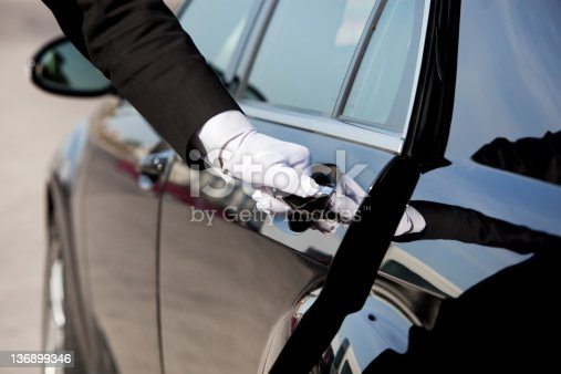 istock Chauffeur opening / closing luxury car door 136899346