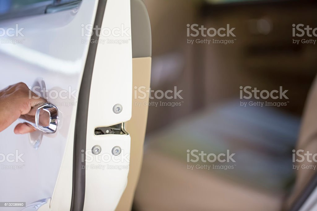 Chauffeur opening door stock photo