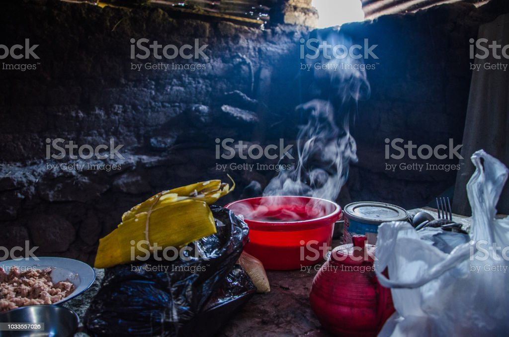 Cheap clay and wooden dish on the table in a village house stock photo