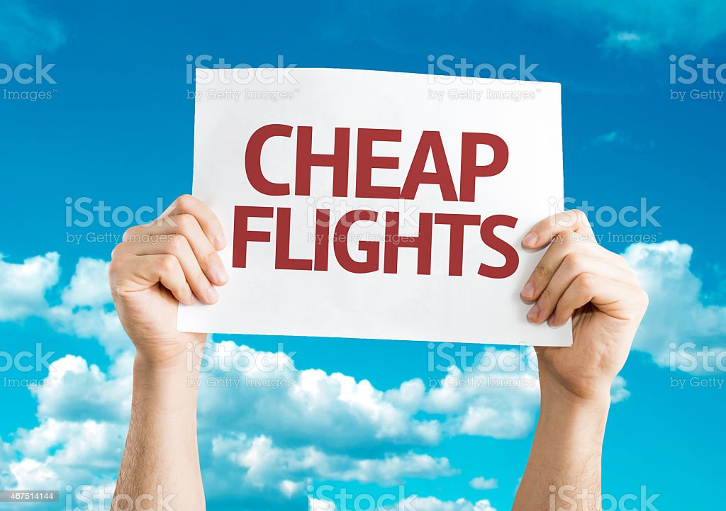 Cheap Flights card with sky background stock photo