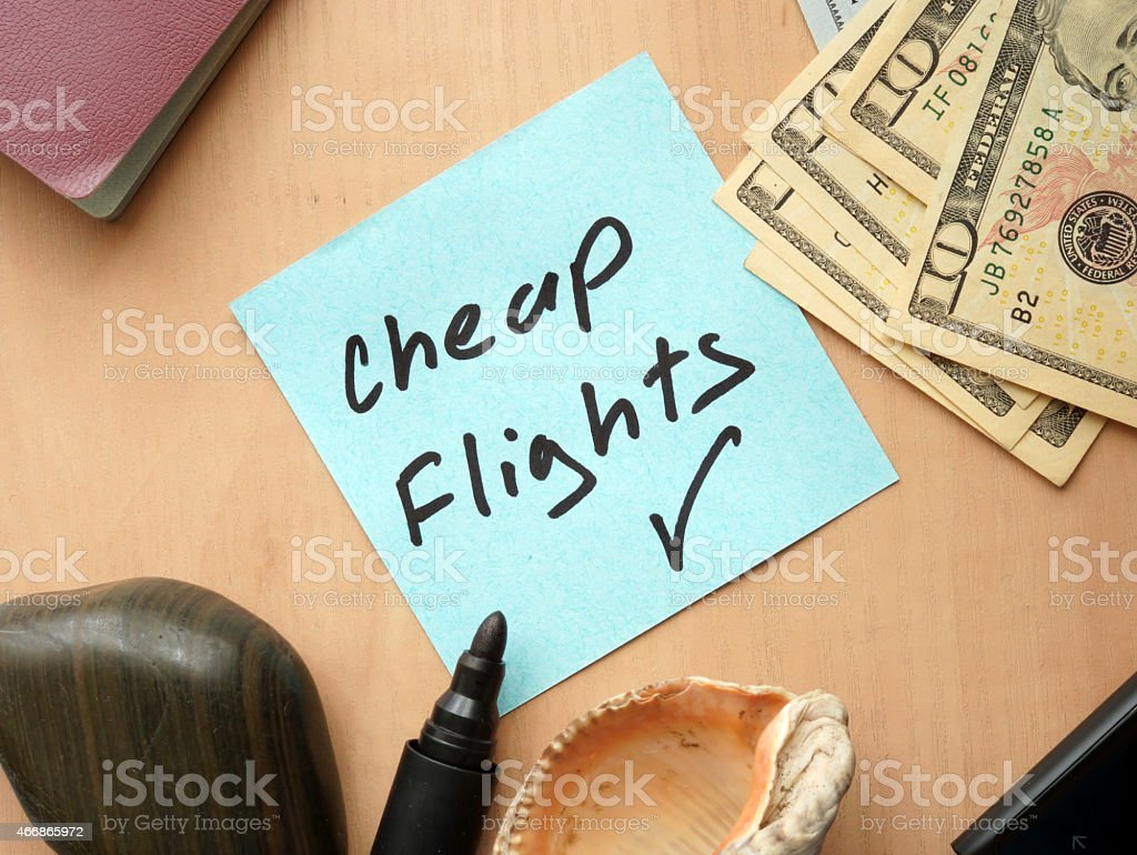 Cheap Flights paper on a table with money stock photo