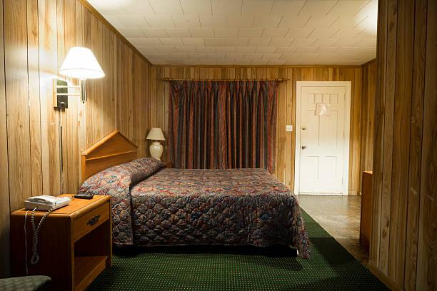 Cheap motel room bed stok fotoğrafı