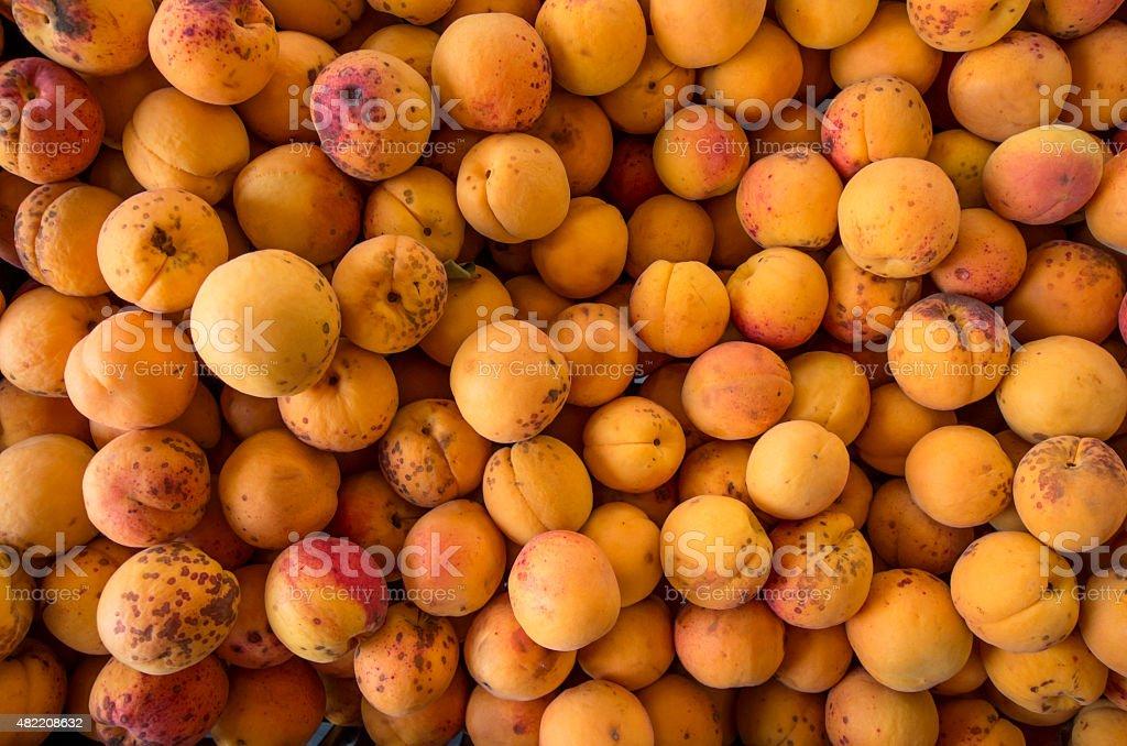 Cheap peach at market stock photo