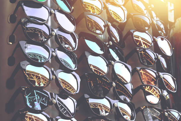 cheap sun glasses on local sunday market in thailand - sale lenses stock photos and pictures