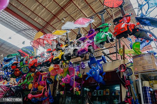 Huaraz, Ancash / Peru - 4. June, 2016: cheap plastic toys on display in the market of Huaraz in Peru wait for a buyer