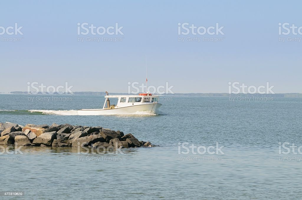 Cheasapeake Bay Crabber Coming Ashore stock photo